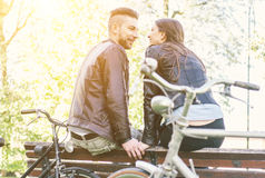 Couple relaxing after a ride in the park with bicycles royalty free stock photo