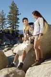 Couple Relaxing On Rocks Royalty Free Stock Photography
