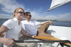 Couple Relaxing In Sailboat Royalty Free Stock Image