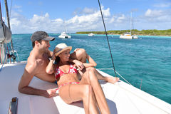 Couple relaxing on a sailing boat in caribbean sea Stock Images