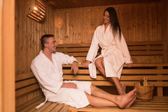 Couple relaxing in the sauna Royalty Free Stock Photos