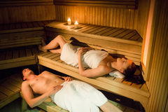 Couple relaxing in the sauna Stock Photography