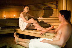 Couple relaxing in the sauna Stock Images