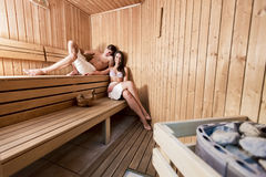 Couple relaxing in the sauna Stock Photos