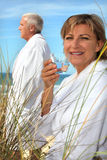 Couple relaxing by the sea Stock Photo