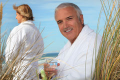 Couple relaxing by the sea Royalty Free Stock Image