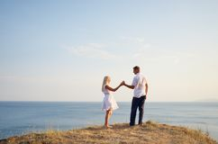 Couple relaxing at the sea Stock Photography