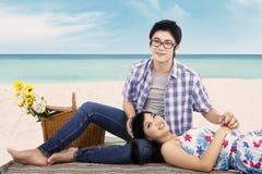 Couple relaxing at seashore Stock Image