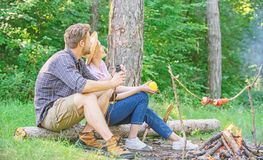 Couple relaxing sit on log having snacks. Hike picnic date. Family enjoy romantic weekend in nature. Pleasant picnic or. Romantic date nature background. Couple stock images