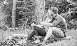 Couple relaxing sit on log having snacks. Hike picnic date. Family enjoy romantic weekend in nature. Pleasant picnic or. Romantic date nature background. Couple royalty free stock images