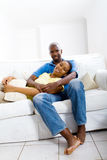 Couple relaxing on sofa Stock Photography