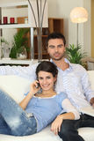 Couple relaxing on sofa Royalty Free Stock Image