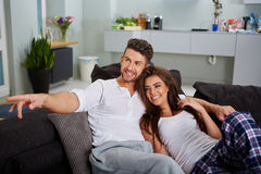 Couple relaxing on a sofa Stock Image