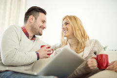Couple relaxing on sofa in free time Royalty Free Stock Images
