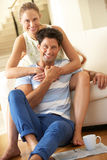 Couple Relaxing On Sofa At Home Stock Images