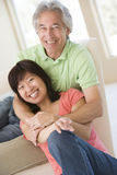 Couple relaxing on sofa at home. Smiling royalty free stock photography