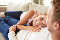 Couple Relaxing On Sofa At Home Together Royalty Free Stock Image