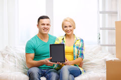 Couple relaxing on sofa with tablet pc in new home Royalty Free Stock Photos