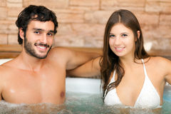 Couple relaxing in a spa Stock Images