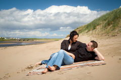 Couple relaxing on summer beach Royalty Free Stock Photo