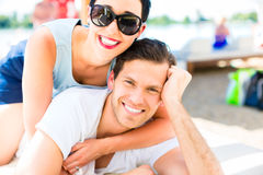 Couple relaxing in summer sun on beach Royalty Free Stock Photo