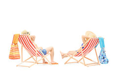 Couple relaxing on a sun loungers Royalty Free Stock Photography