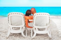 Couple relaxing on sunbed Stock Photography