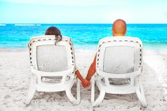 Couple relaxing on sunbed. Loving Couple relaxing on sunbed. Summer Vacation Stock Photo