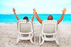 Couple relaxing on sunbed Stock Photo