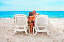 Couple relaxing on sunbed Royalty Free Stock Images