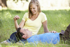 Couple Relaxing In Sunny Summer Field Royalty Free Stock Images
