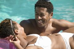 Couple Relaxing in Swimming Pool stock photography