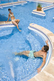 Couple relaxing in swimming pool.  royalty free stock images