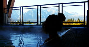 Couple relaxing in swimming pool. During wintertime stock footage