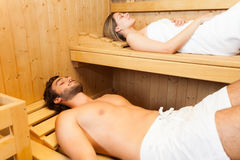 Couple relaxing while taking a sauna Royalty Free Stock Image