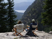 A Couple Relaxing and Taking in the Vista. The picture of this couple sitting in chairs on the rock ledge enjoying the solitude and vista was taken in the Royalty Free Stock Photography