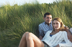 Couple relaxing In Tall Grass Royalty Free Stock Photography
