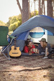 Couple relaxing in tent Royalty Free Stock Images