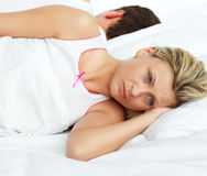 Couple relaxing in their bed Royalty Free Stock Photography