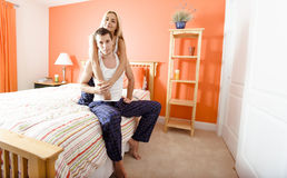 Couple Relaxing in Their Bedroom Stock Photo
