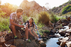 Couple relaxing on their hiking day Royalty Free Stock Photos