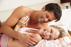 Couple Relaxing Together In Bed Royalty Free Stock Images