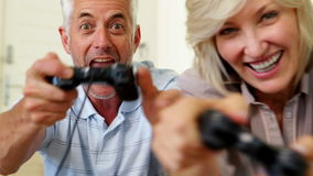 Couple relaxing together on the couch playing video games stock footage