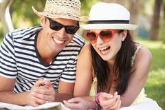 Couple Relaxing Together In Garden Royalty Free Stock Photo