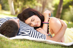 Couple Relaxing Together In Garden Royalty Free Stock Image