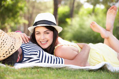 Couple Relaxing Together In Garden Royalty Free Stock Images