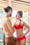 Couple relaxing together at spa pool Stock Photos