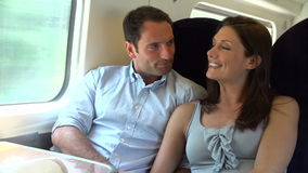 Couple Relaxing On Train Journey Together Royalty Free Stock Photography