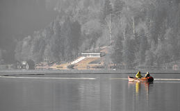 Couple on relaxing trip rowing boat on lake bled in winter Royalty Free Stock Image