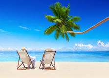 Couple Relaxing on the Tropical Beach Stock Images